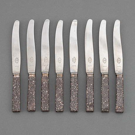 A set of eight porphyr knives, early 20th century.
