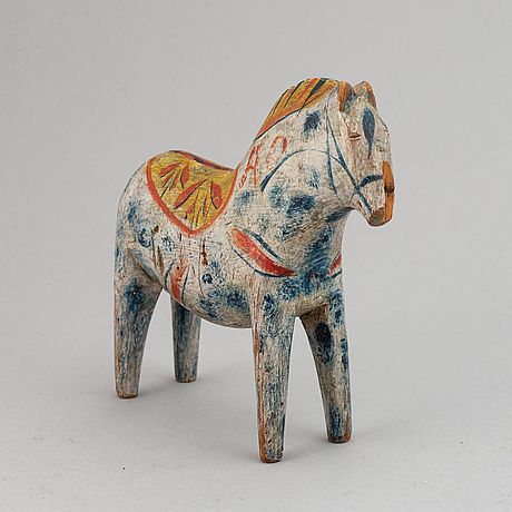 A wooden carved and painted 'dalahäst', early 20th century.