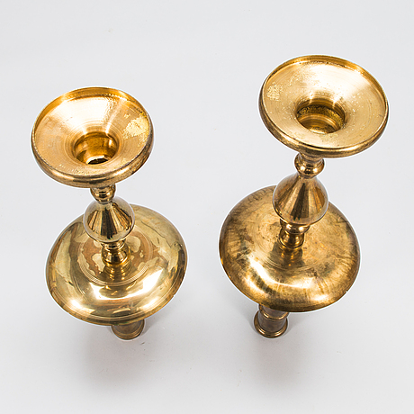 A pair of floor candle holders in brass, 20th century.