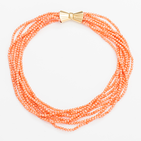 A eight-strand coral pearl collier with an 18k gold clasp.