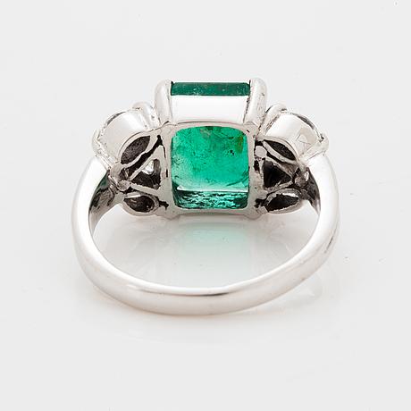 Emerald-cut emerald and diamond ring.