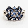 A 14k white gold ring with sapphires. finnish import marks, 1970.