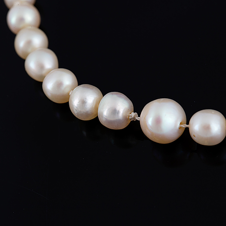 Cultured pearl necklace, clasp white gold with old-cut diamond.