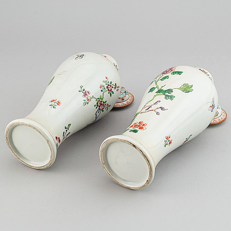 A pair of french famille rose samson vases with covers, end of 19th century.
