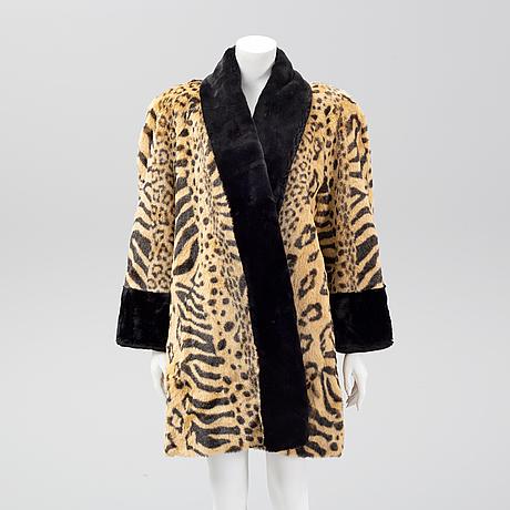 A fake fur coat, size ca medium.
