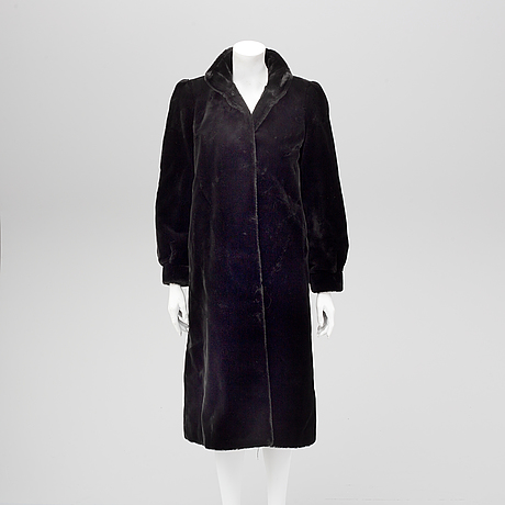 A fake fur coat, size ca medium.