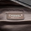 Chanel, a grey leather bag.