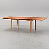A 1950/60's dining table from slagelse møbelvaerk a/s with two additional leaves.