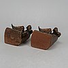 Two brass book ends, 20th century.