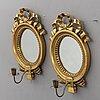 A pair of 20th century mirror sconses.