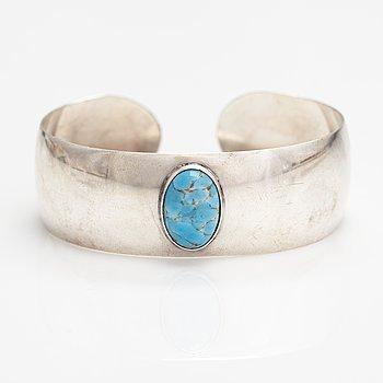 Holger Lindström, A silver bracelet with a glass sotne. Helsinki 1959.