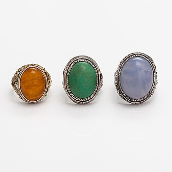 Three silver rings with an amber, turquoise and chalcedony. China. Finnish import marks.