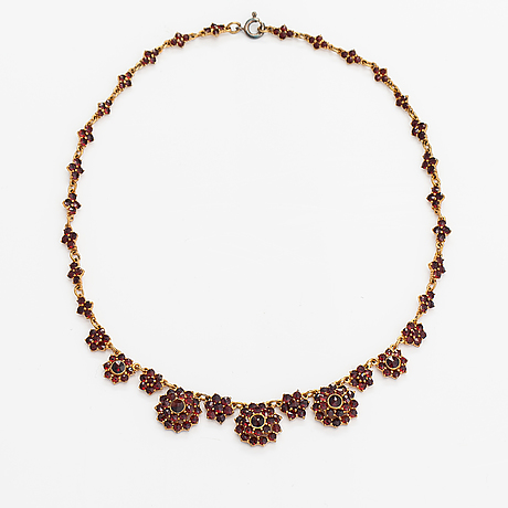 A gilded silver jewellery suite with garnets. swedish import marks.