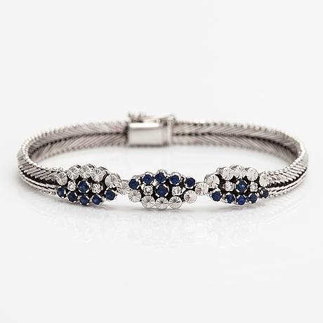 Rannekoru, 18k valkokultaa, safiireja ja timantteja n. 0.18 ct yht.