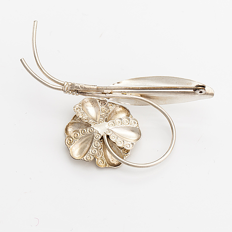 Elis kauppi, a silver brooch with glass stones. kupittaan kulta, turku 1940's.