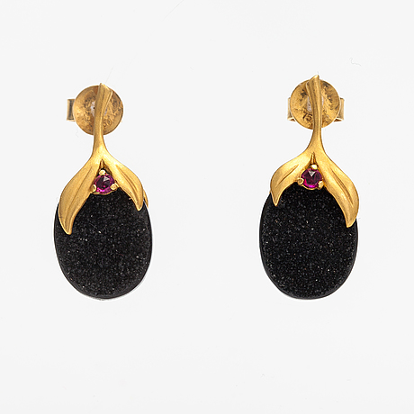 Annoushka, a pair of 18k gold earrings with drusy onyxes and rubies. london.