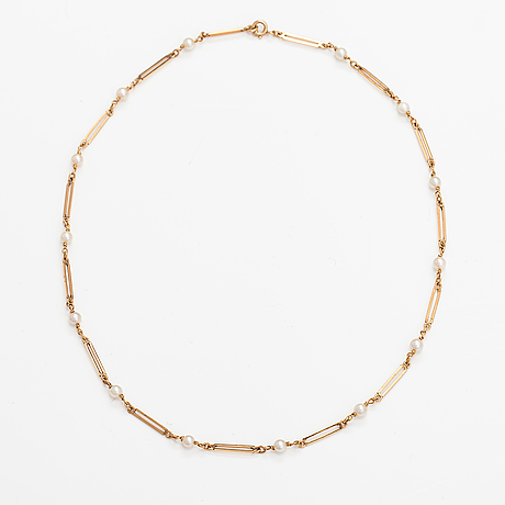A 14k gold necklace with cuktured pearls. westerback, helsinki 1965.