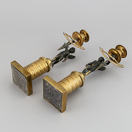 A pair of empire candlesticks, first half of the 19th-century.