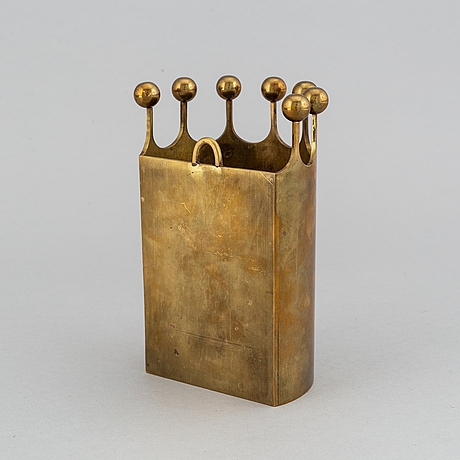 A wall-mounted brass vase by pierre forsell from skultuna.