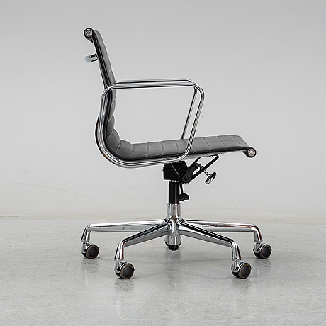 An ea 117 swivel armchir by charles and ray eames for vitra, designed 1958.