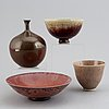 Isak isaksson, a mixed lot of glazed ceramics, three bowls and a vase, signed.