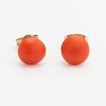 A pair of 14K gold earrings with coral beads.