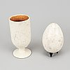 Hans hedberg, a faience sculpture of an egg and a vase / egg cup, biot, france.