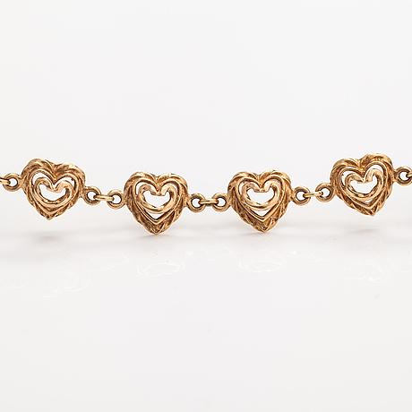 """Tony granholm, a 14k gold bracelet """"heart of the house"""". kalevala koru, helsinki 2002."""