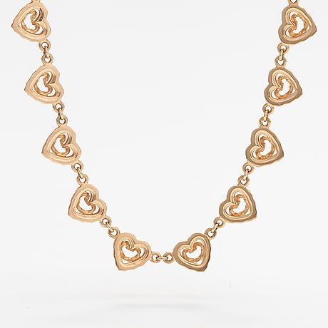 """Tony granholm, an 18k gold necklace """"heart of the home"""". kalevala koru, helsinki 2004."""