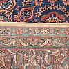 A carpet, semi-antique kerman ca 420 x 311 cm.