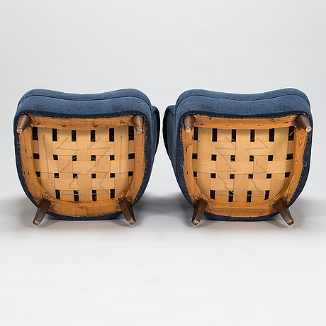 A pair of mid-20th-century armchairs.