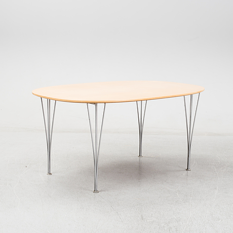 A 'super-elliptical' table by bruno mathsson & piet hein for fritz hansen 2001.