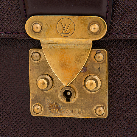 Louis vuitton, a taiga leather 'minuto' briefcase.