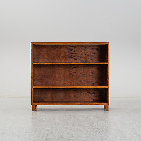 A 1940's stained birch book shelf.