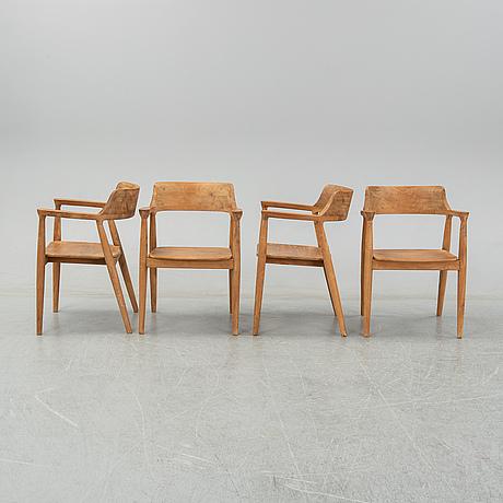 Four contemporary teak armchairs.