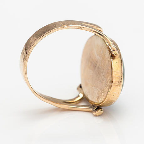 A 14k gol ring with a nefrite and dimaonds ca. 0.02 ct in total. lagercrantz jewellery, tammisaari 2012.