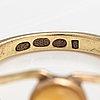 A 14k gold ring with an opal. lagercrantz jewellery, tammisaari 2006.
