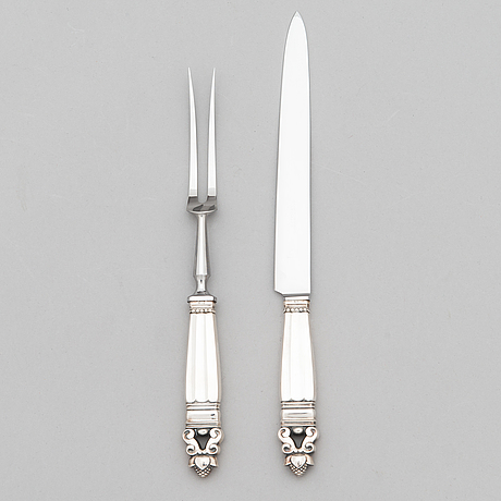 Johan rohde, a sterling silver carving knife and fork set, 'konge/acorn', georg jensen, denmark.