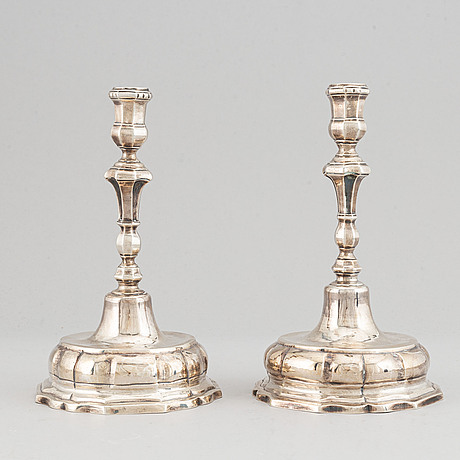 A pair of 18th century silver candlesticks, possibly spain.