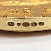 An 18k gold medal alvar aalto finlandia. designed by eila hiltunen. kultateollisuus, turku 1974. numbered 3.