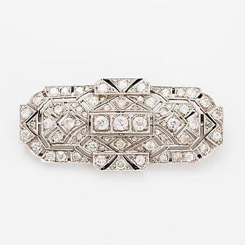 Old-cut and rose-cut diamond brooch, total ca 2,40 ct.