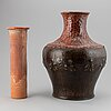 A large earthenware and copper vase, easy 20th century.