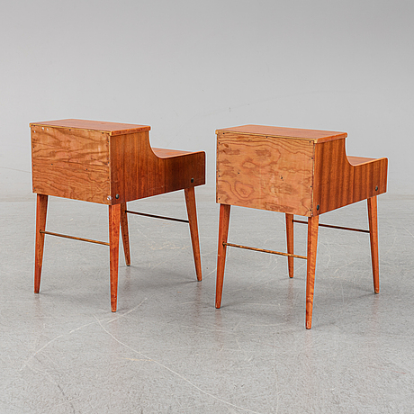 A mid 20th century pair of mahogany beside tables.