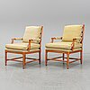 A pair of late 20th century armchairs.