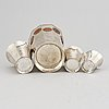 4 swedish silver beakers with older coins.