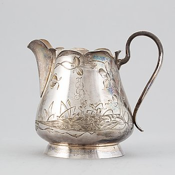 A Russian late 19th / early 20th century parcel-gilt silver cream-jug.