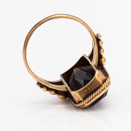 A 14k gold ring with a smoaky quartz. asser peltonen, vantaa.
