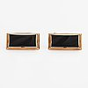 A pair of 14k ogld cufflinks with onyxes. nummilan koru, turku 1967.