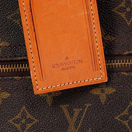 Louis vuitton, a garment cover.