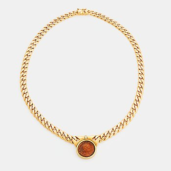 """364. A Bulgari """"Monete"""" necklace in 18K gold with a roman coin and a baguette-cut diamond."""